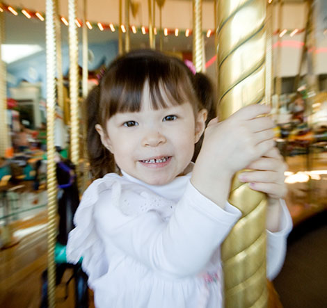 Kadie on the carousel for her birthday