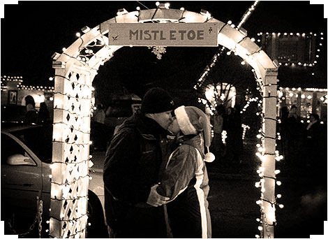 Kissing under a mistletoe at Peacock Lane